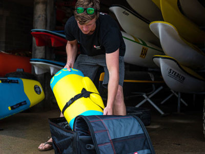 Unpacking inflatable rescue board at surf lifesaving club