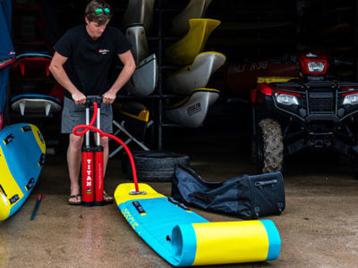 pumping up inflatable rescue board with our titan pump