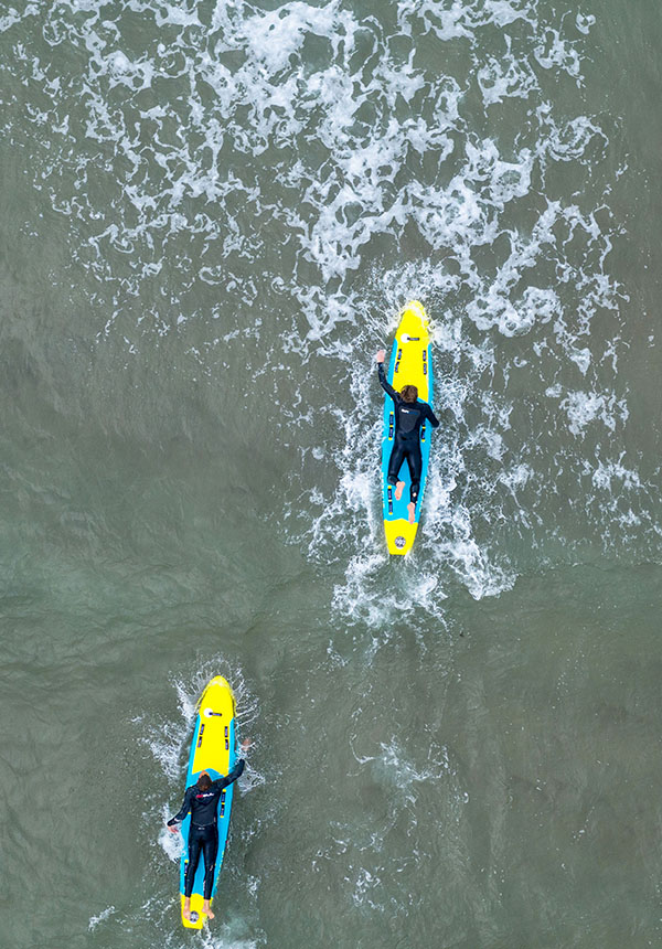 Surf lifesaving rescue boards being paddled